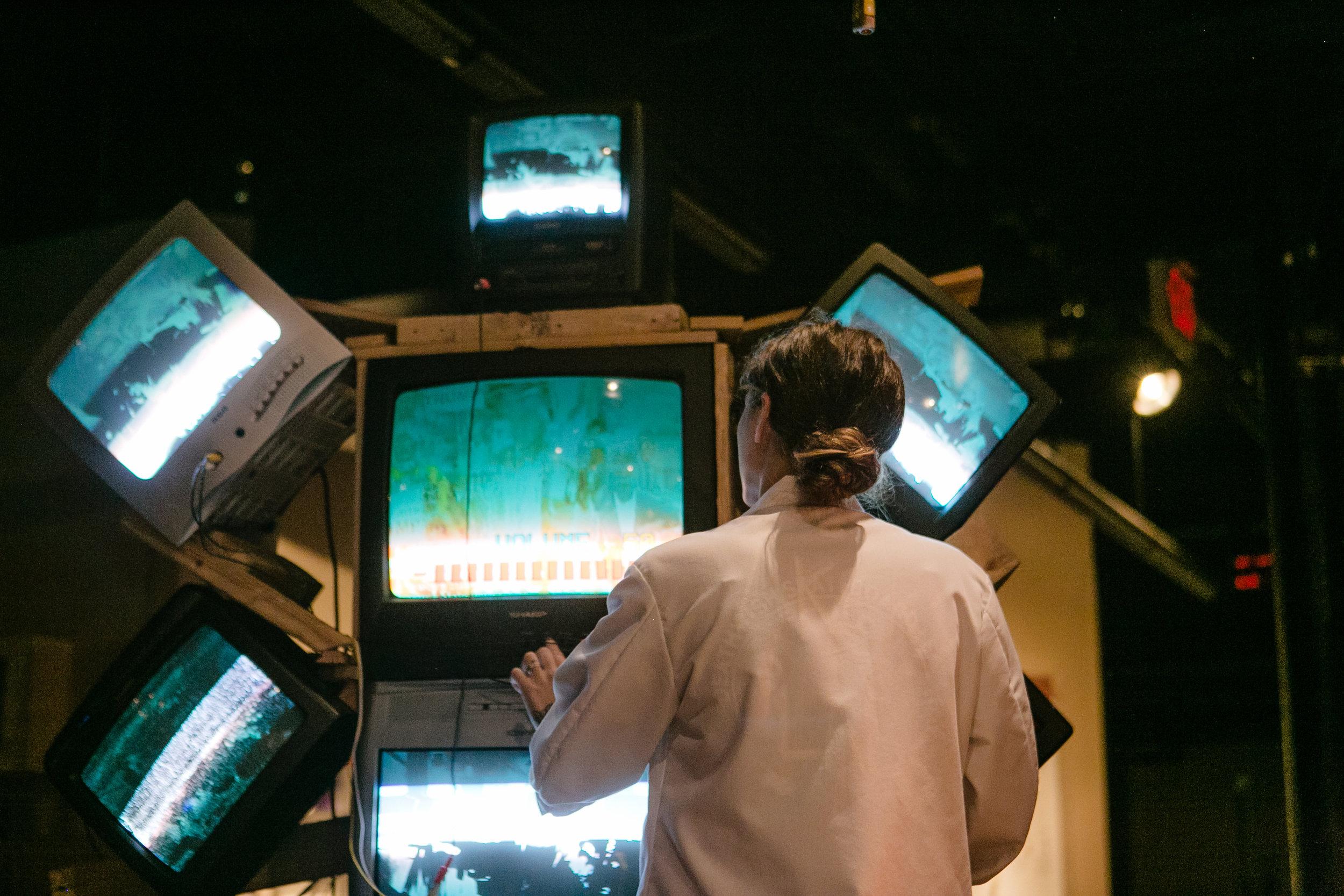 Emily Bartelt with TVs.jpg