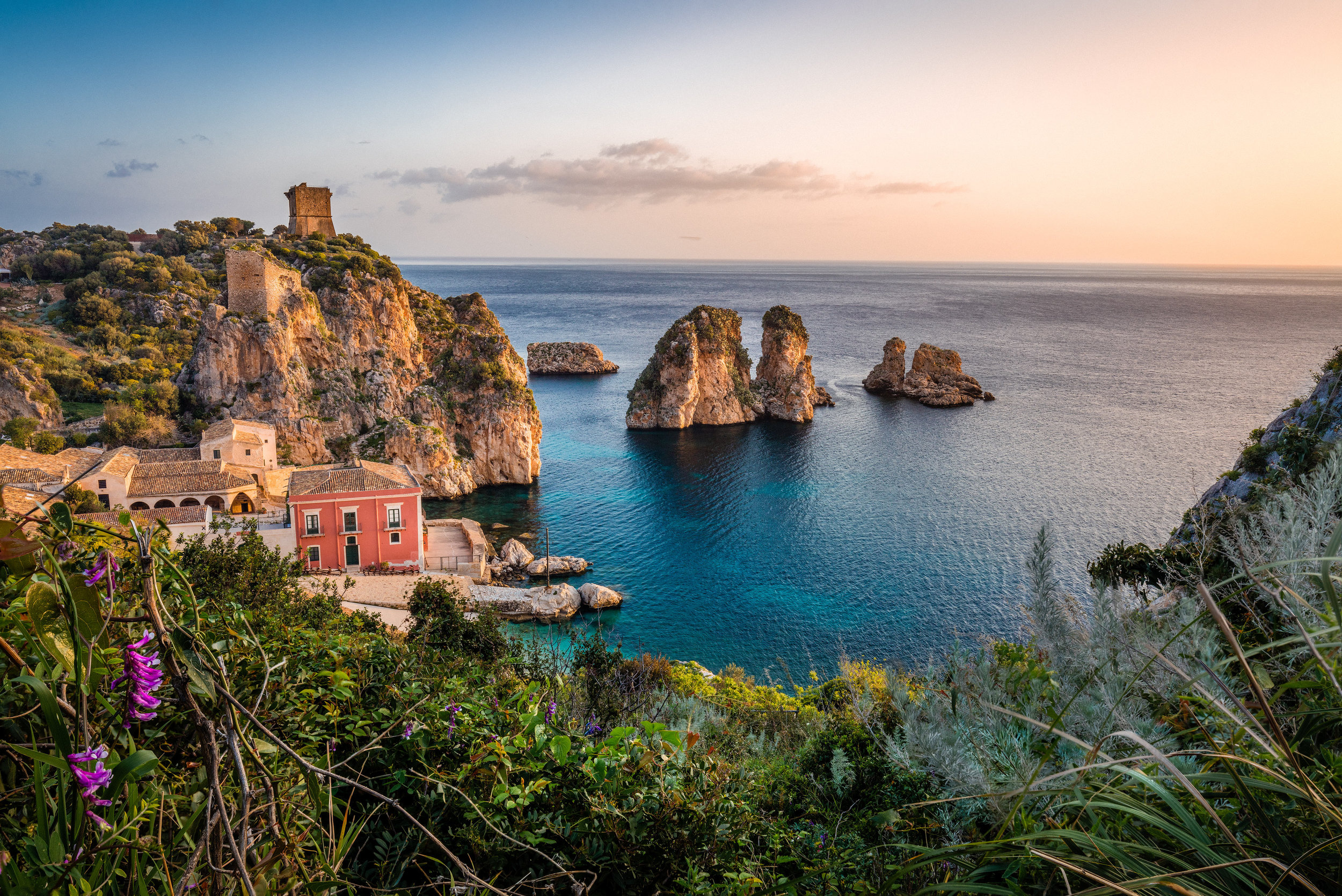 Taormina - Set high upon a hill overlooking the Ionian Sea, the ancient city of Taormina is a must visit. One can simply wander along charming cobblestone streets or enjoy an espresso and become whisked away to a romantic, dreamy Italian experience.