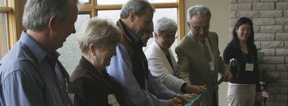 Grand Opening April 2006:   From left ; former Mayor of Mulmur Township Gord Gallaugher, Past President of Rotary Club of Toronto Sylvia Milne, Pine River Founding Board Chair Ron Crane.  The Way Back  Campaign Chair Don Wright, Pine River Founder Karen Minden, Pine River Founding Board Member Michael Morgan, Pine River Co-Founder Samantha Yamada (far left, holding the other end of the ribbon, Pine River Co-Founder Elyse Schipper)