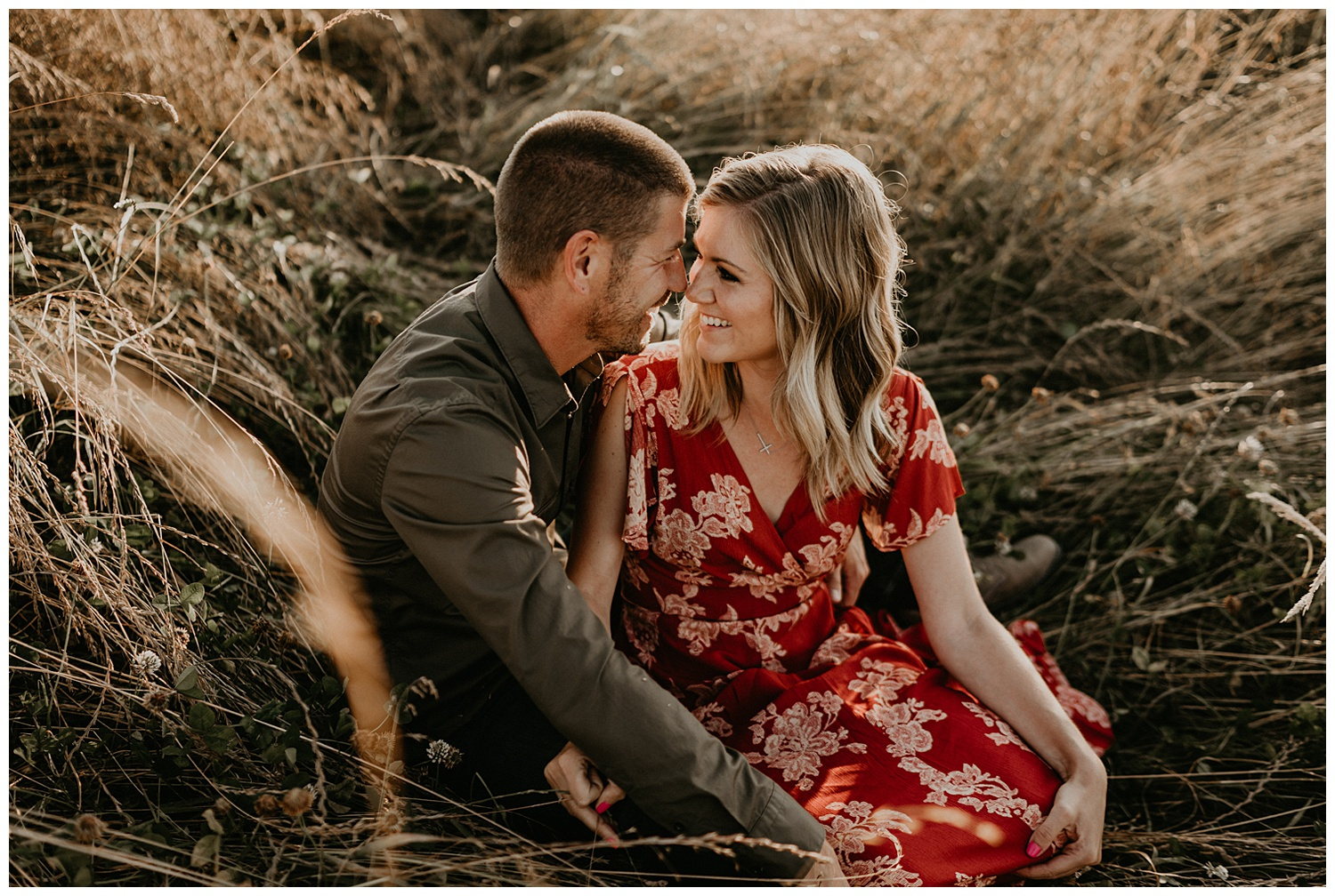 couple laughing in a field