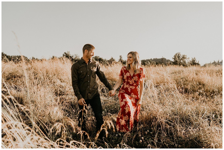 couple walking in an open field
