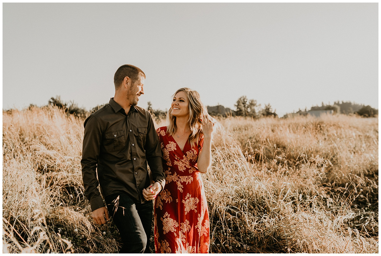 golden hour tall grass engagement session
