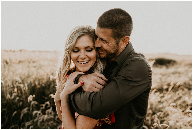 cute couple posing in field