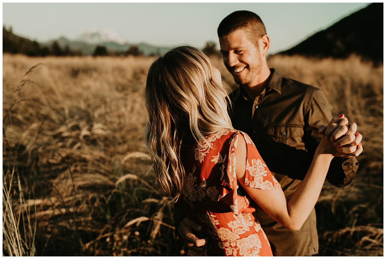 cute couple dancing in field