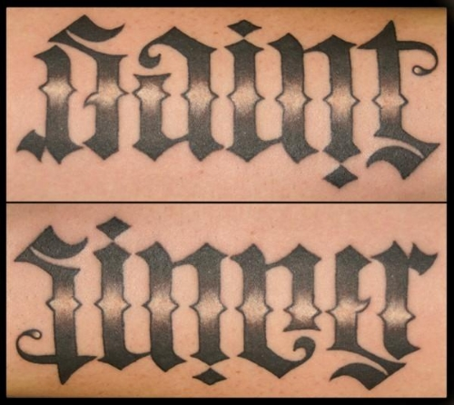 A popular tattoo: the same word reads 'saint' one way, and 'sinner' the other.