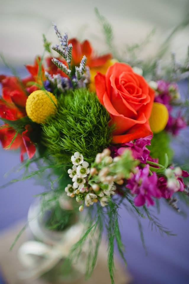 All the summer colors with orange roses and craspedia