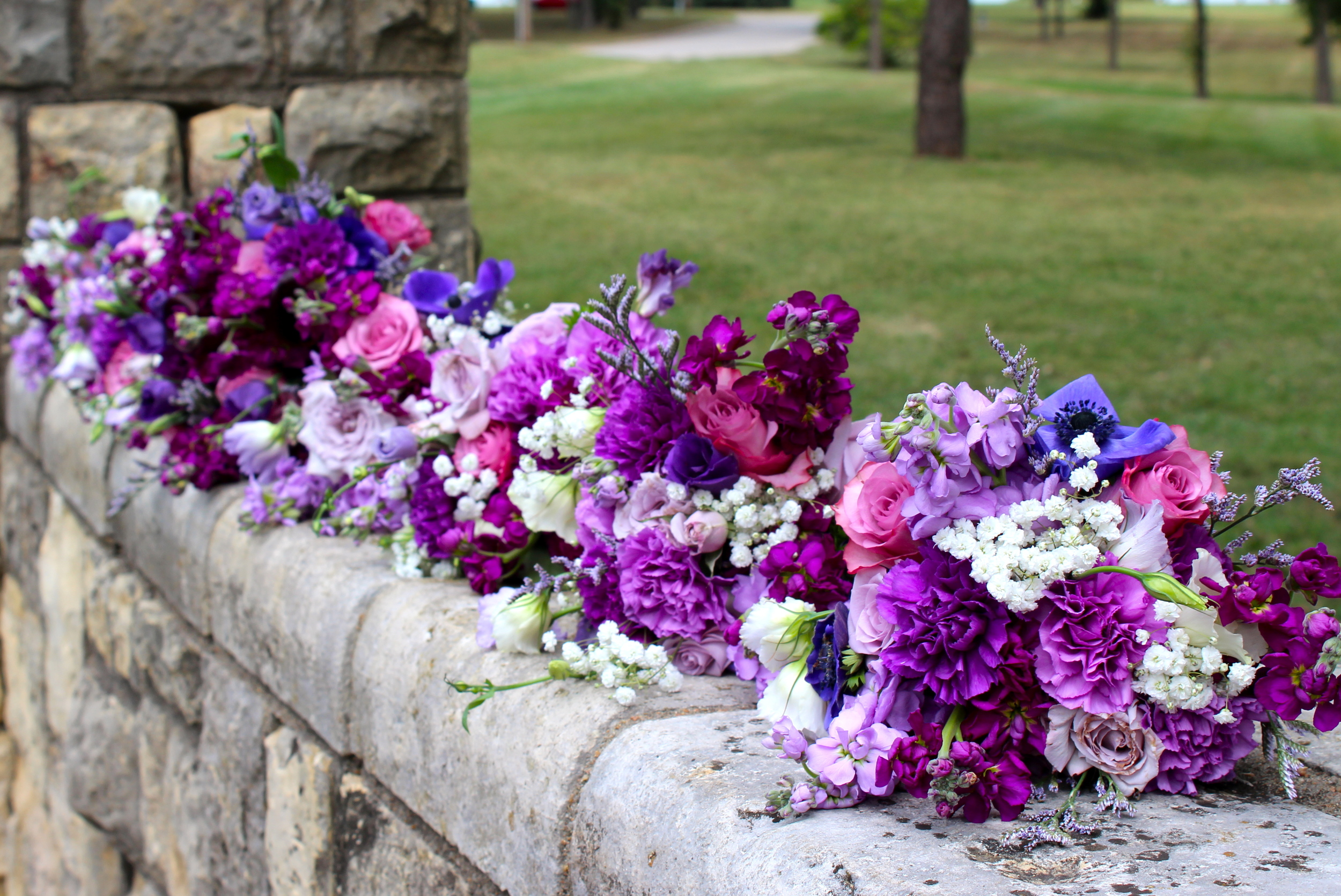Mixed purple bouquets with carnations and roses