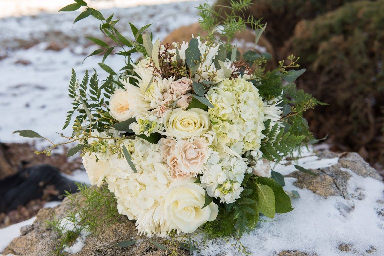 Snowy day with blush and cream flowers