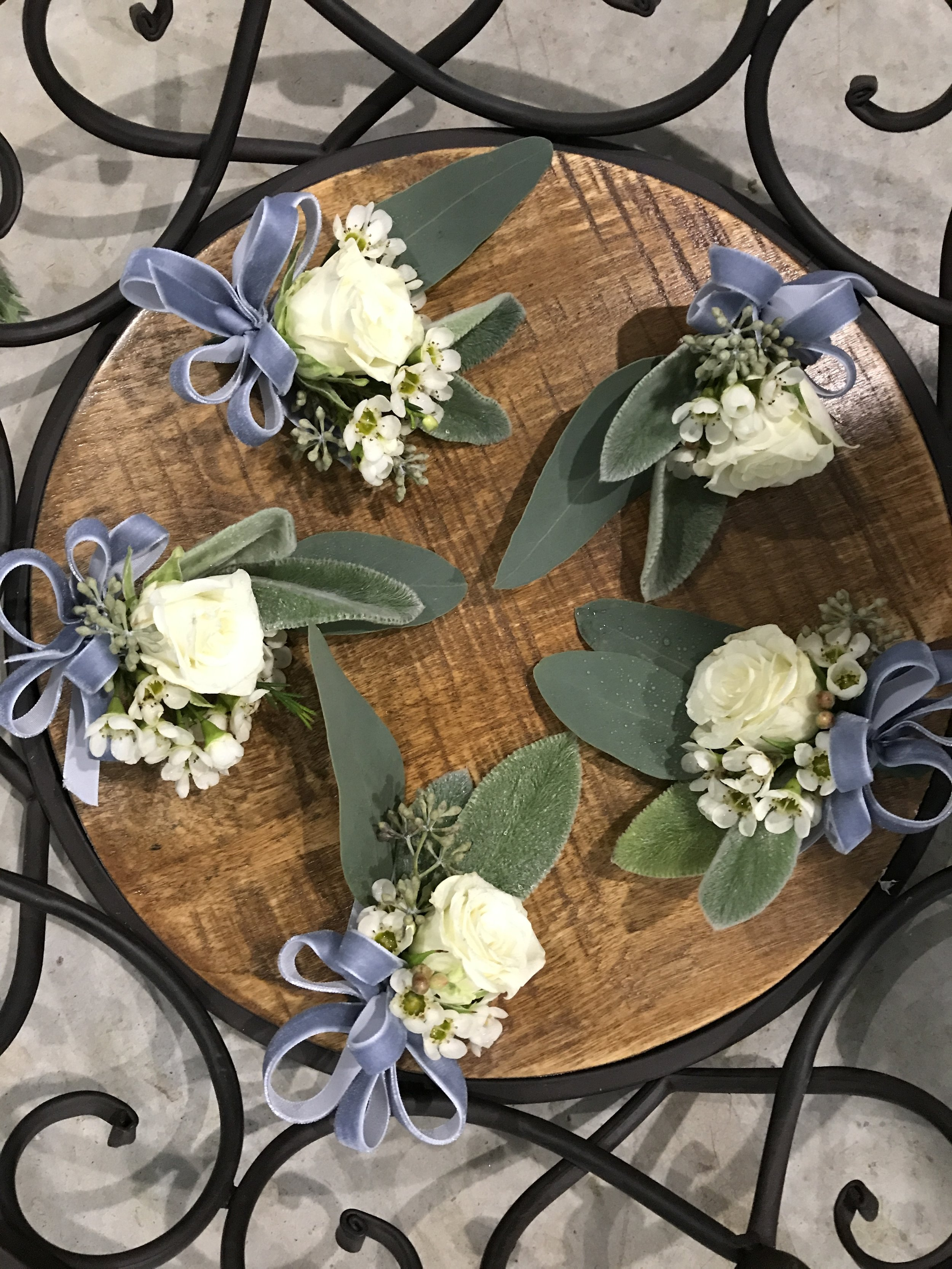 Dainty corsages with dusty blue velvet ribbon