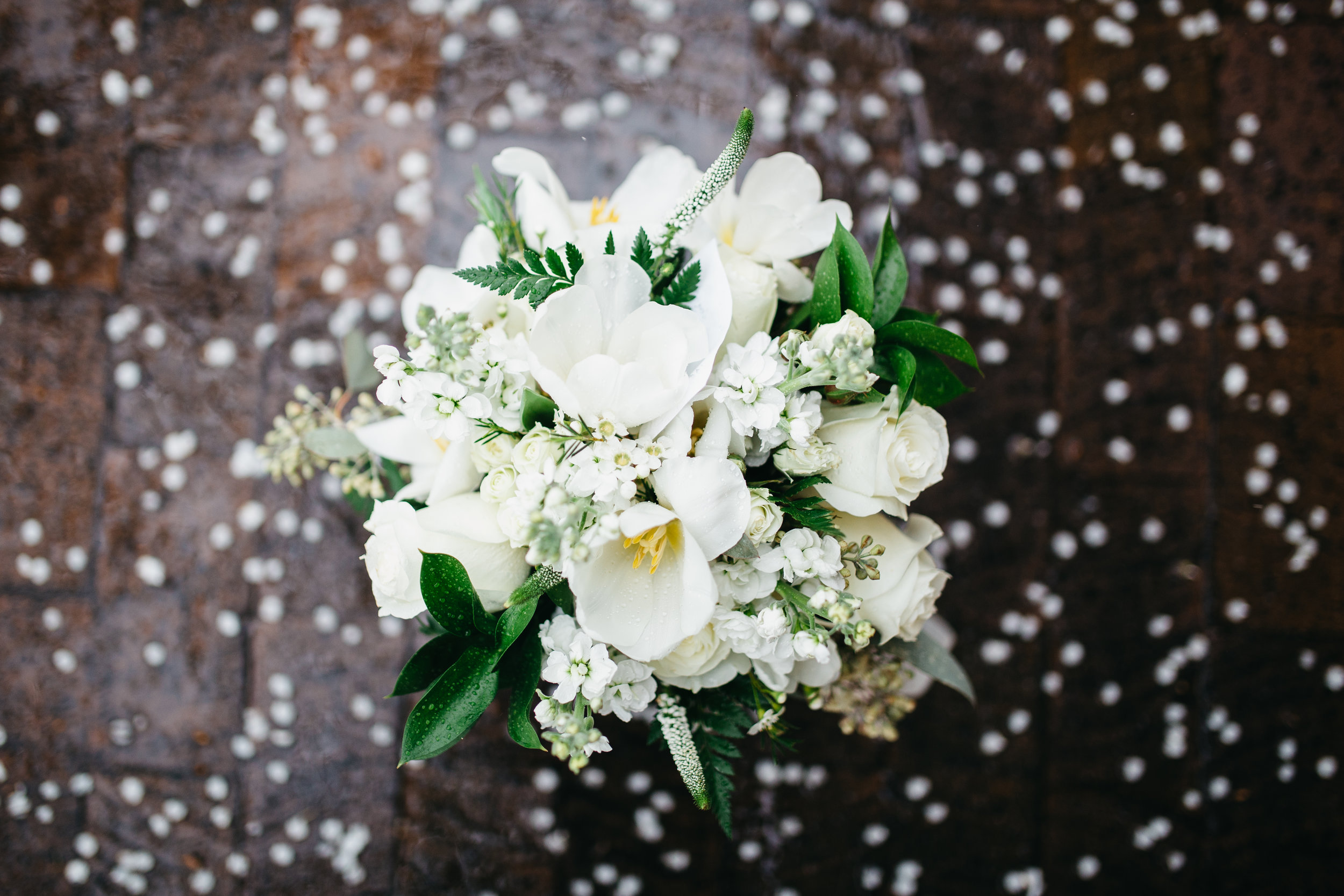 Beautiful rainy day with all white bouquet