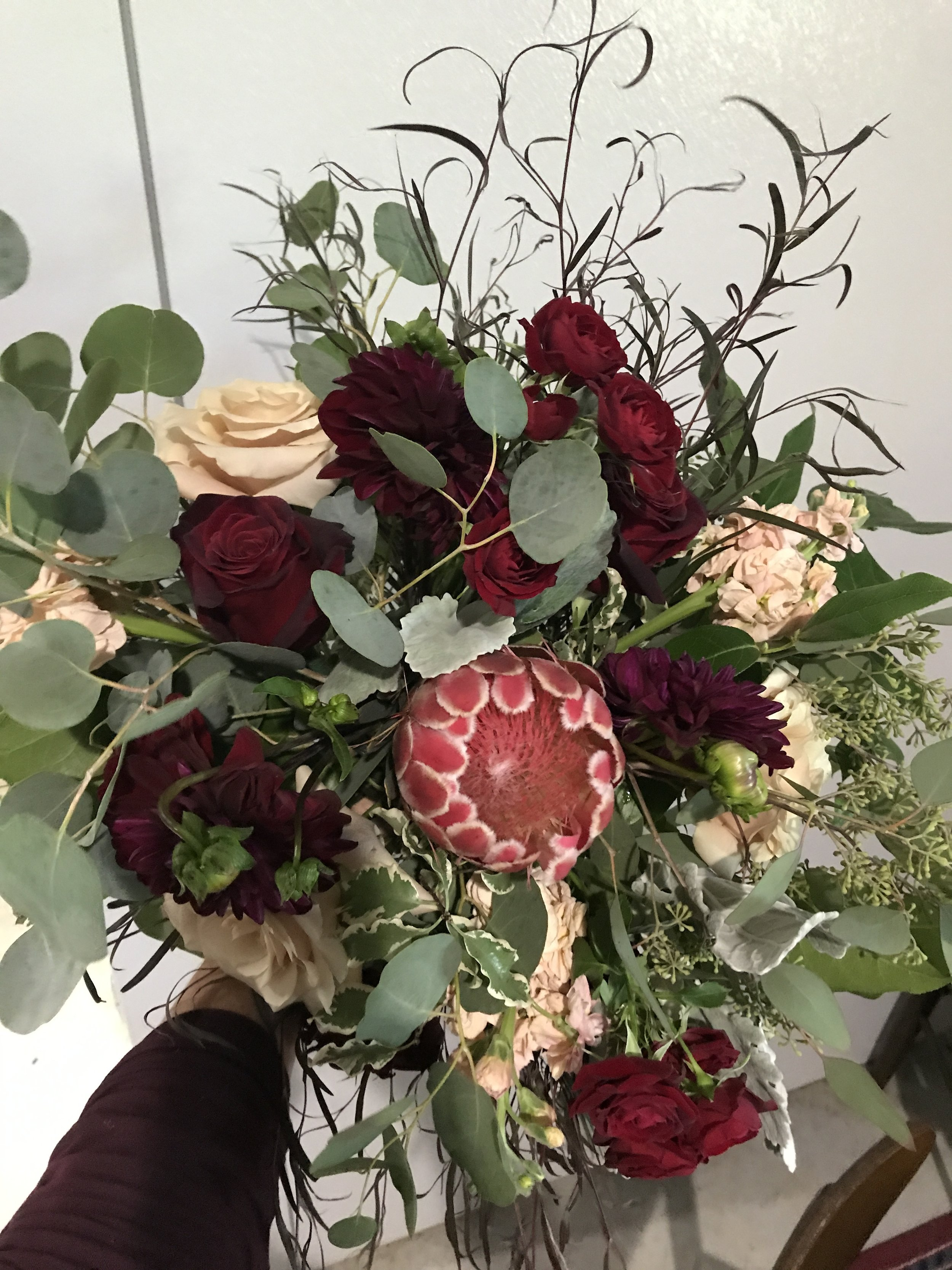 Burgundy and blush with protea