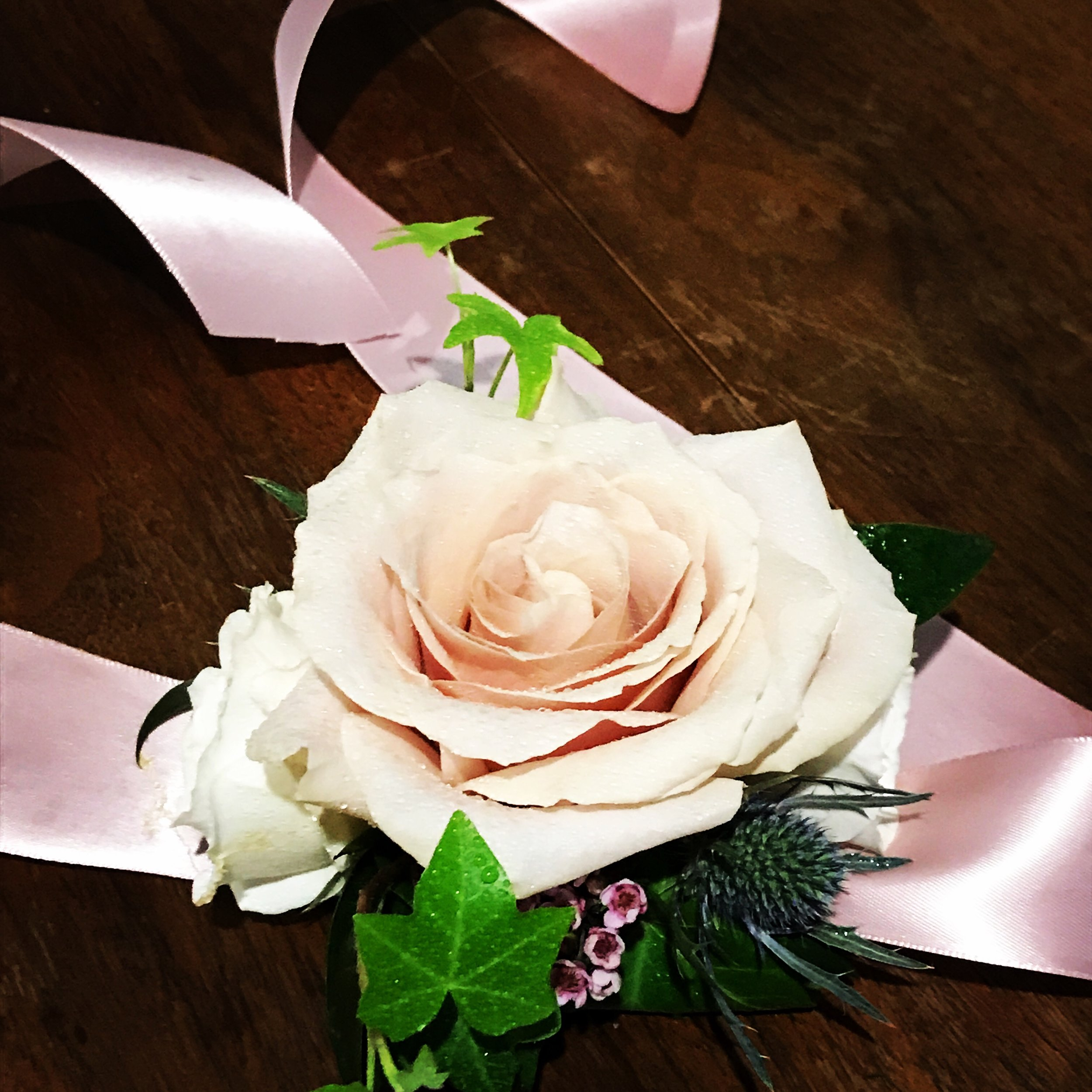 A perfect blush rose corsage