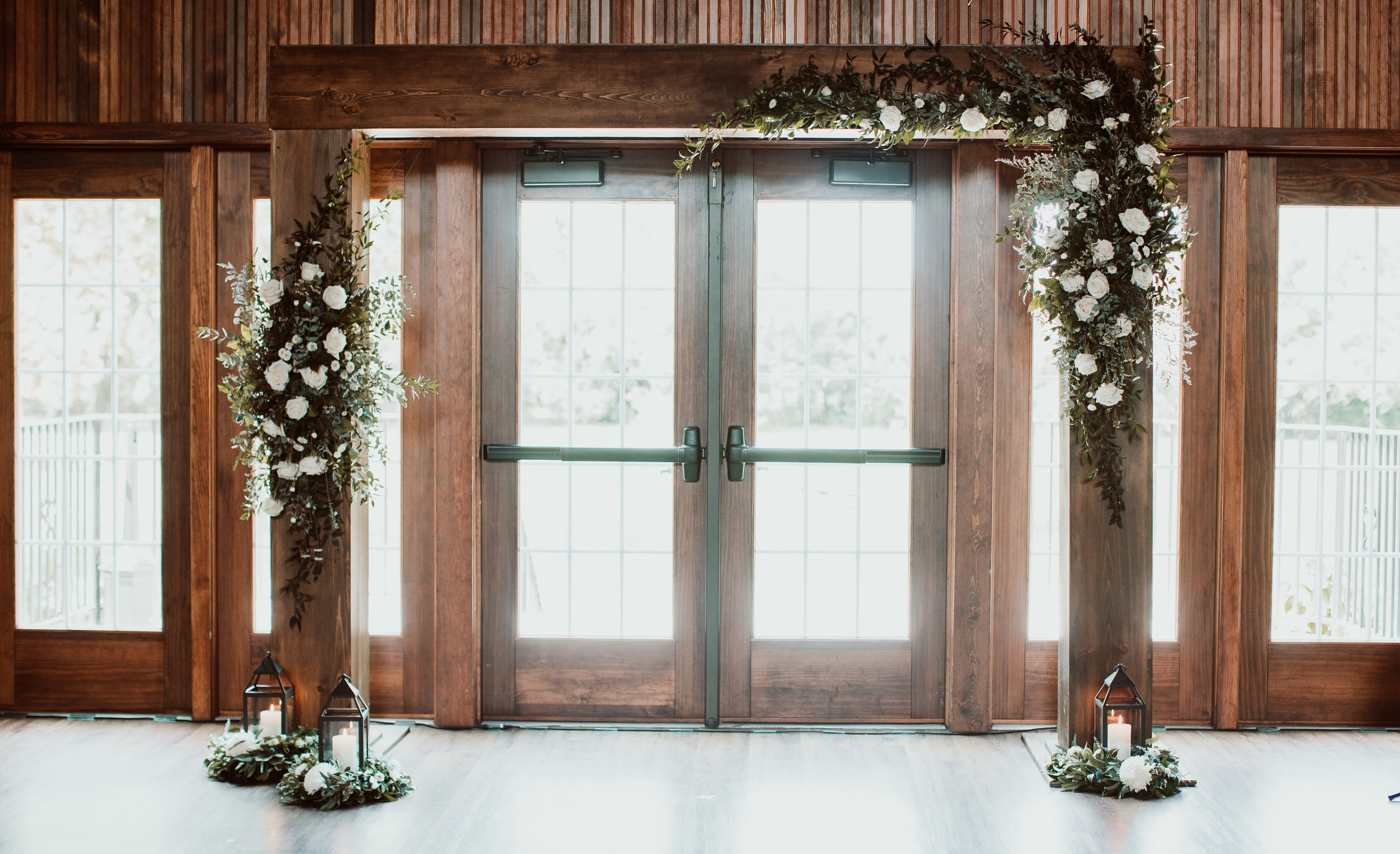 Ceremony Arch with all white flowers and mixed greenery