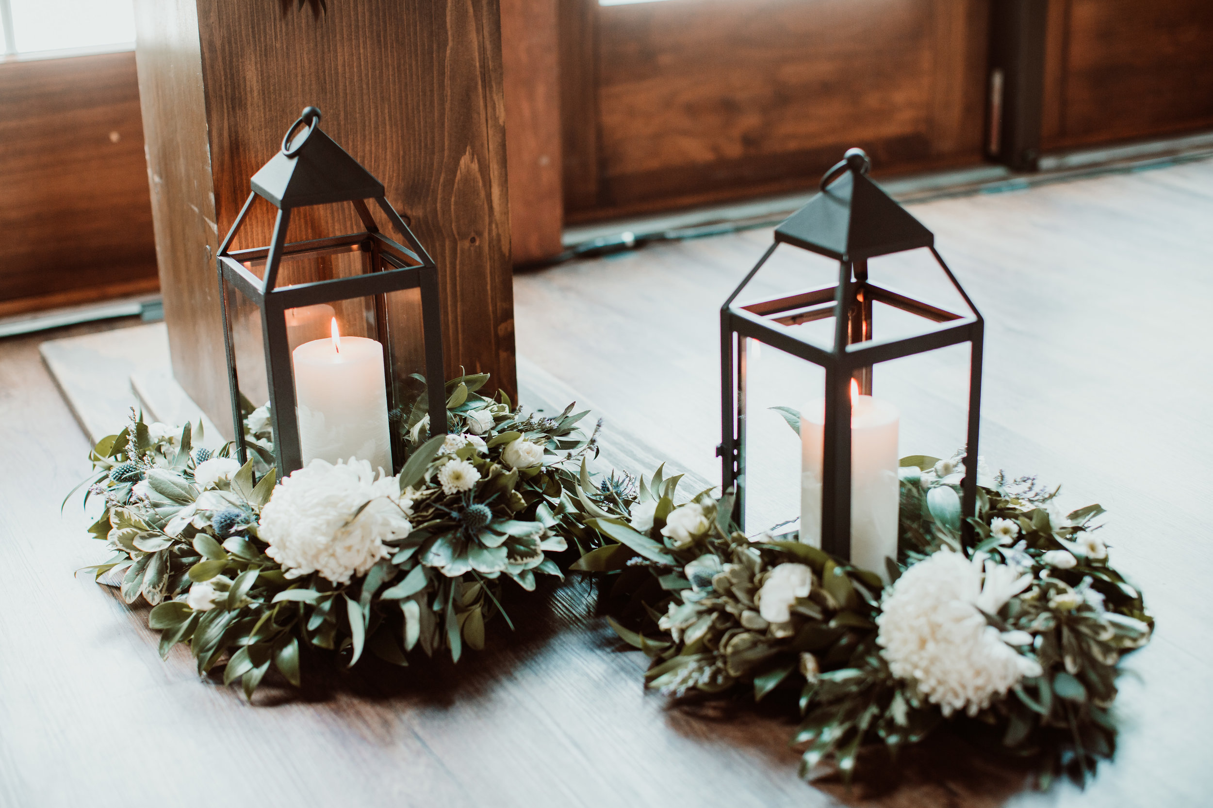 Lanterns with garland and flowers