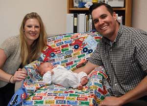 Tiffany, Baby Jack, and Travis Jokerst. Photo by Alyssa Burley.