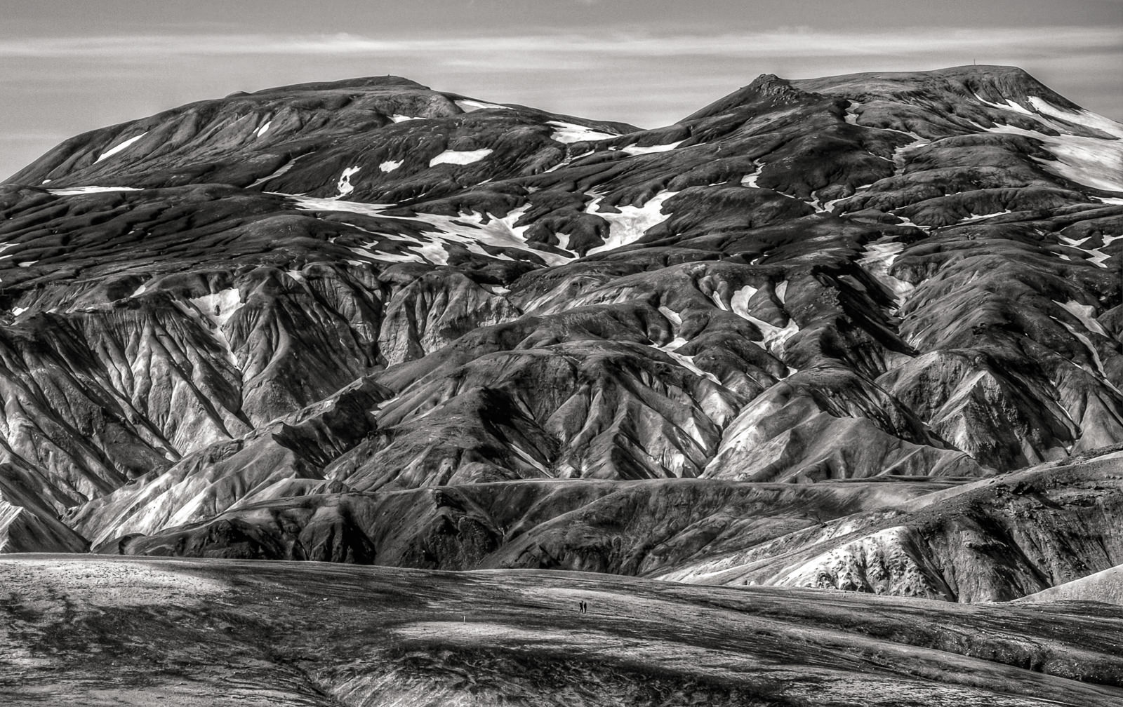 "Two hikers ""lost"" in the vastness of the Landmannalaugar Highlands."
