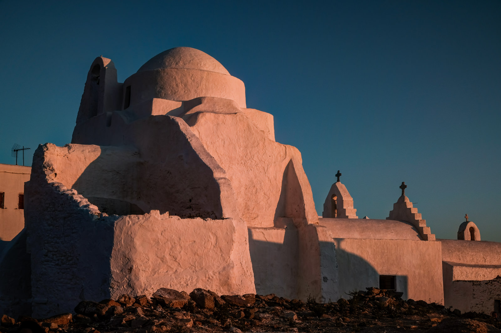 Sunset paints the Church of Panagia Paraportiani pink