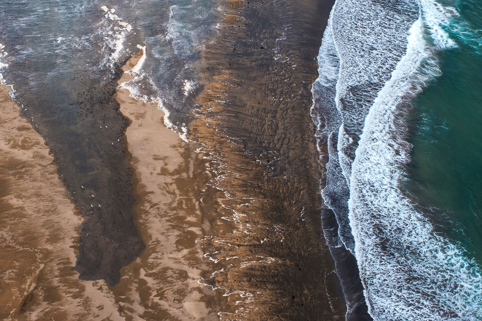 West Iceland coast line from above, shot taken from a small airplane (Cessna). A few flying birds on a left side for scale.   (XF 16-55mm f2.8 at 22mm 1/1000 f4.5 ISO800)