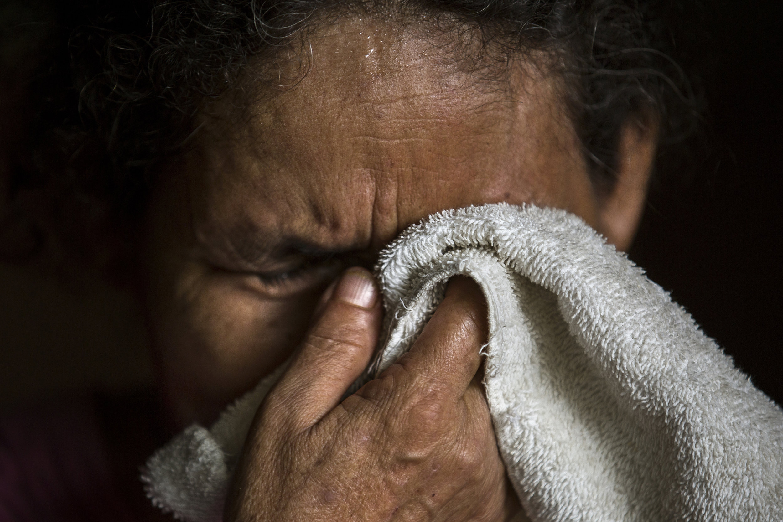 SAN HILARIO, EL SALVADOR. Maria Leoneor Arevalo Romero cries while thinking of her two sons Ernesto de Jesus Arvelao Medina, recently killed by gang members in their hometown of in San Hilario in El Salvador, and Jose Adrian Zamora Arevalo who was detained by immigration officials in the United States for entering the country without the proper documentation.
