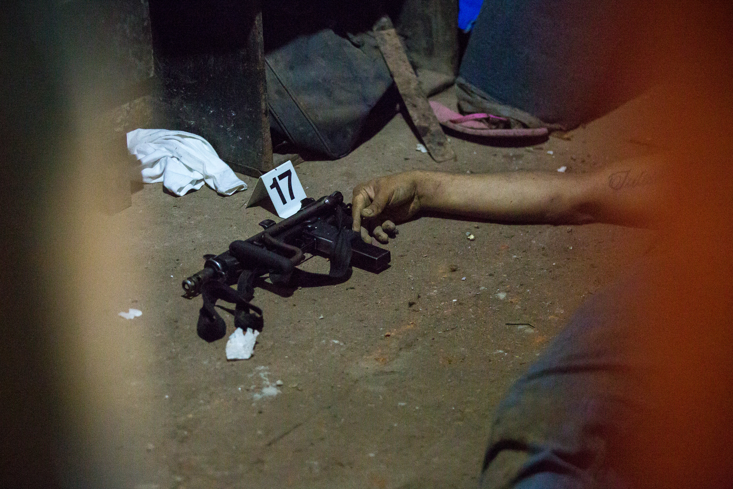 AYAGUALO, EL SALVADOR.The dead body of an gang member at the scene of a gang-police shootout.