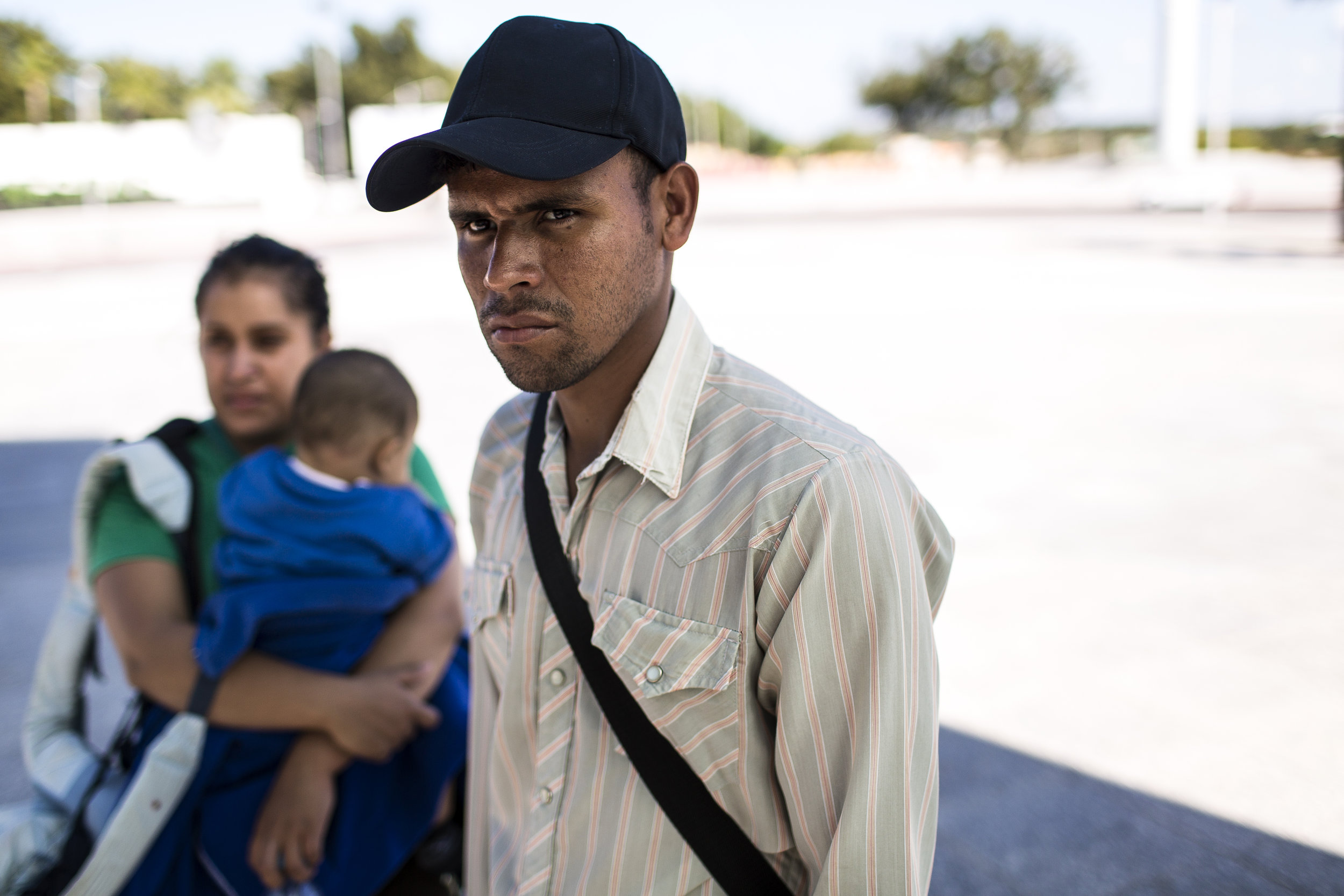 The Carias family leaves the US-Mexico border overlook in Piedras Negras, Mexico, after spotting a group of young men that make them uneasy. They have heard about individual migrants and also families being abducted and held for ransom and Dikeni was even kidnapped on an earlier trip to the United States. Photo by Martin do Nascimento