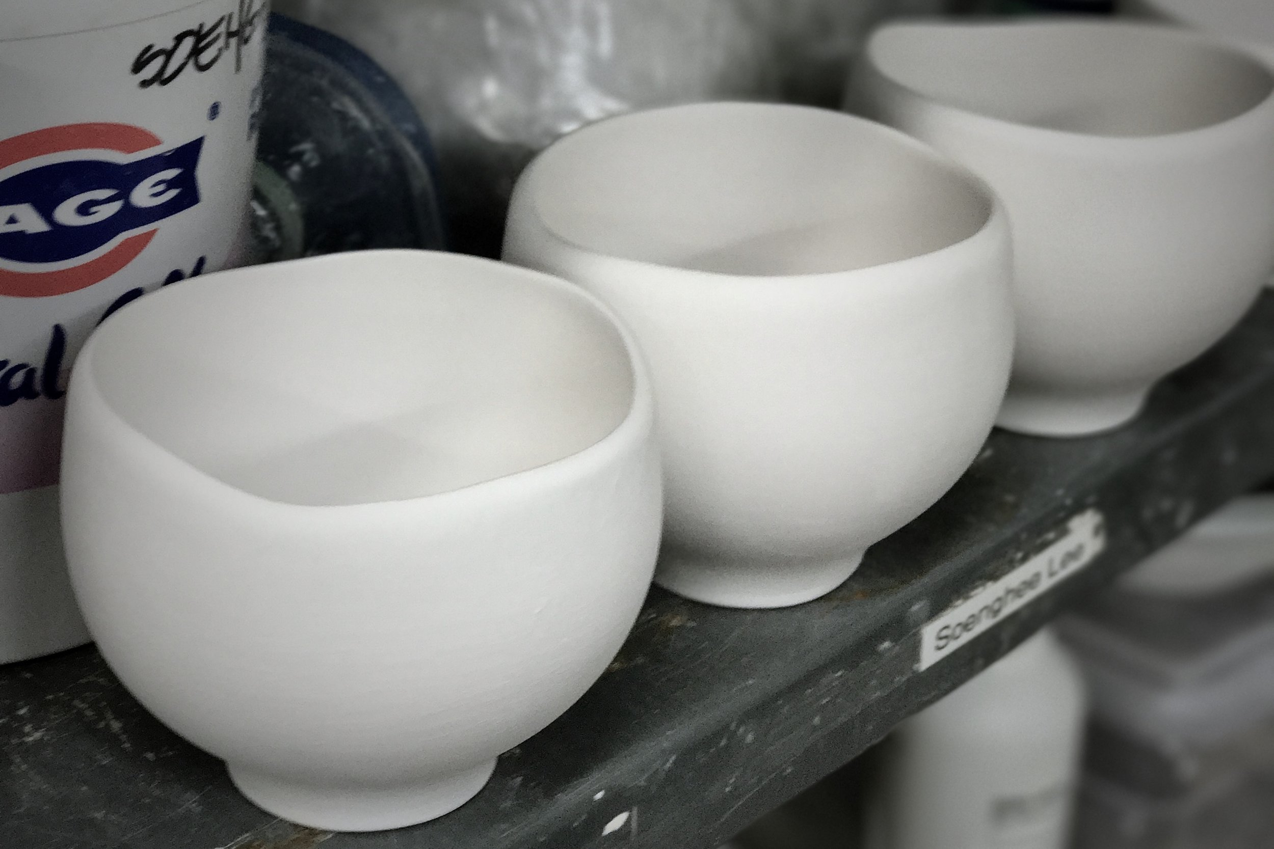 porcelain slipcasting cups. Rim of each cup has carefully crafted variations of curves.