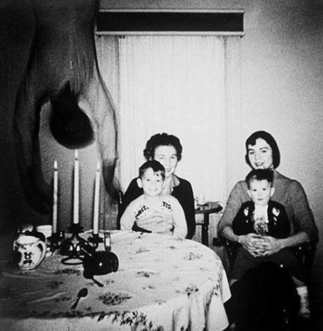 a terrifying photograph taken at god knows when from god knows where. Spoiler alert, the family died. Just kidding, well the family is likely dead now but not because of an upside down flailing shadowmonster...i think.