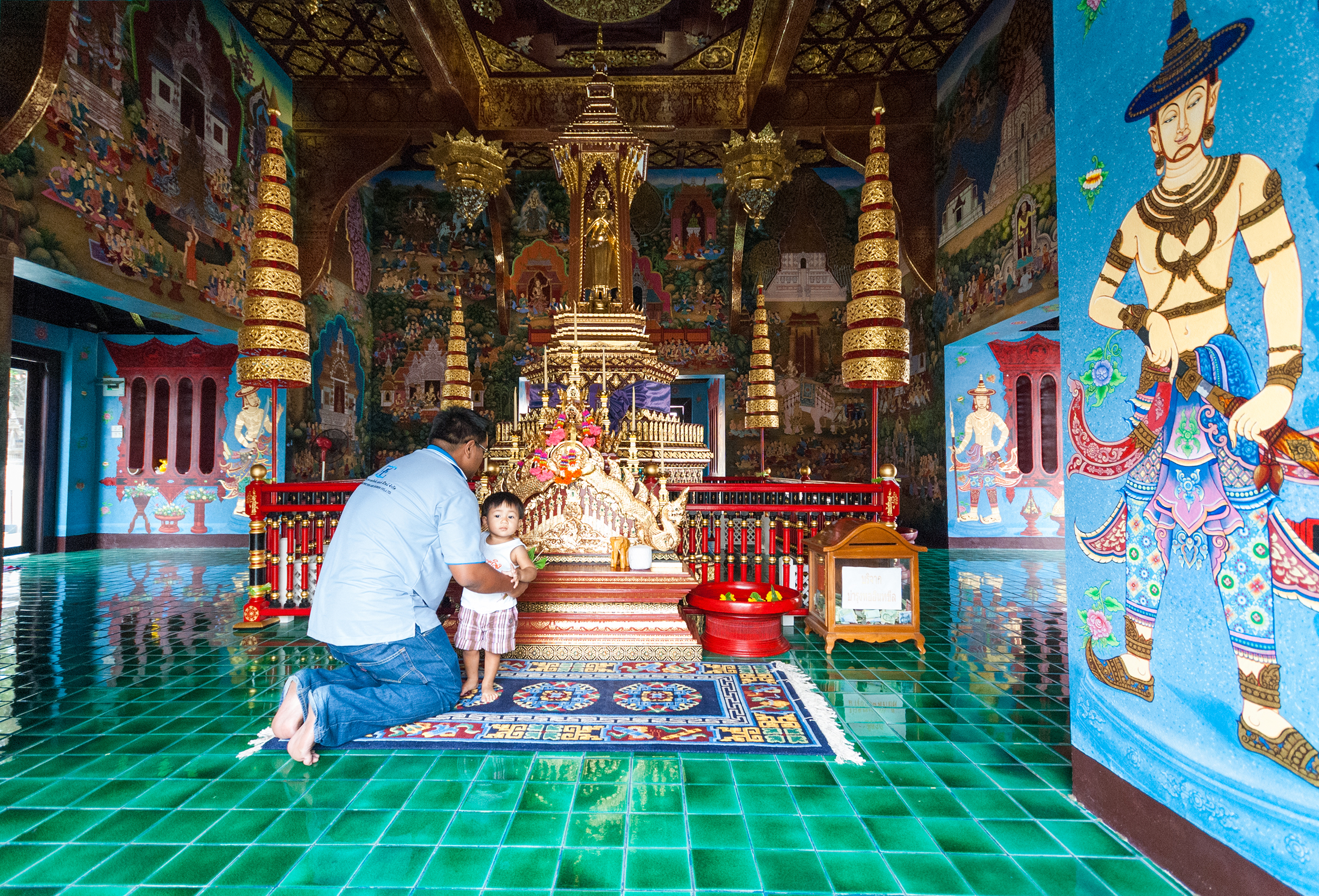 In Wat Chedi Luang temple complex, there is a temple where only men enter, where fathers take their sons to pray. Chiang Mai, Thailand