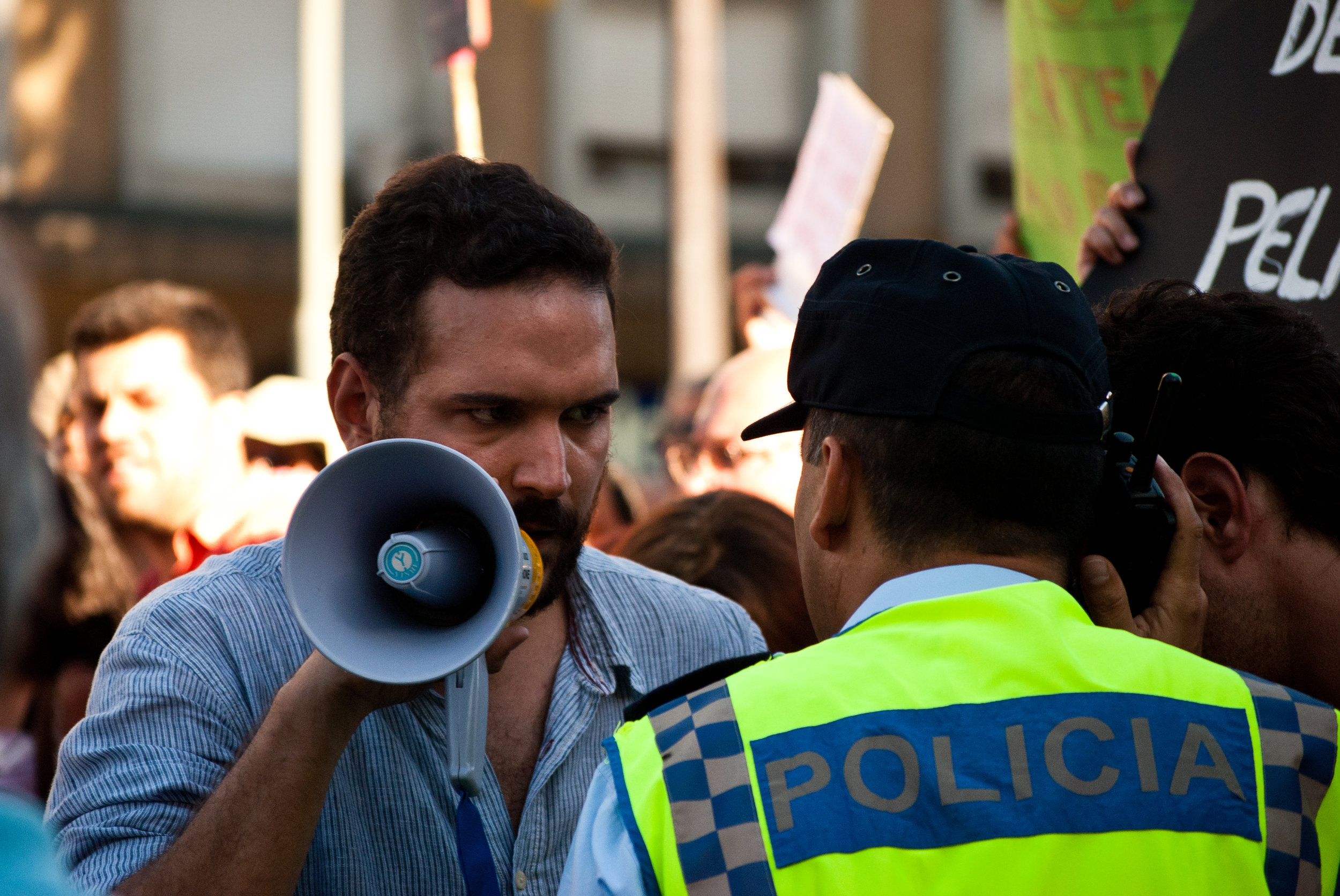 15/09/2012, One of the protest's having a confrontation with a policeman. More than 100,000 people took to the streets of Lisbon and other Portuguese cities to protest against fresh austerity measures recently announced by the centre-right government.
