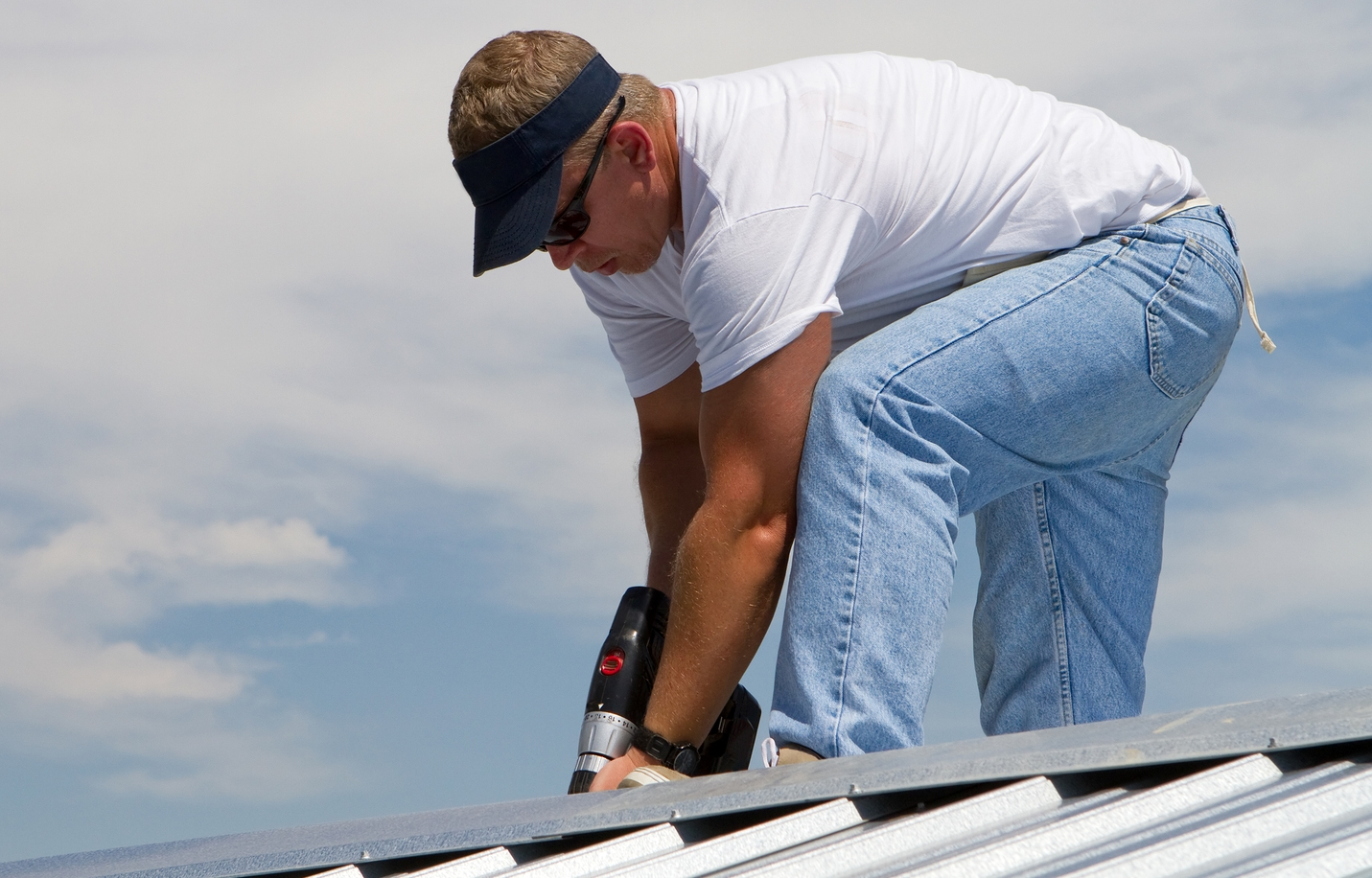 A man installing custom roof flashings in Sydney