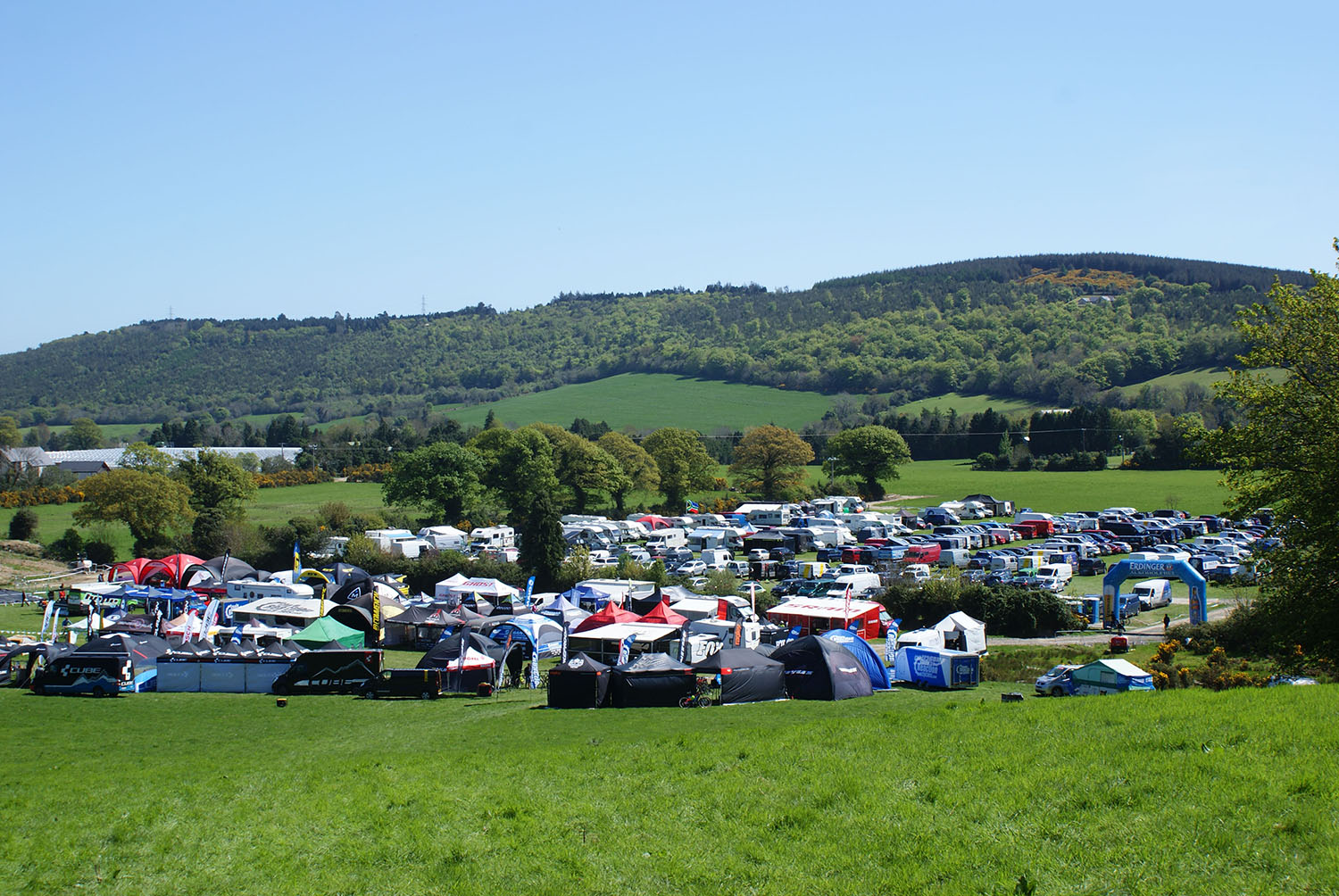 The race village and start/ finish area amidst luscious green fields. Photo: Philip Ellis
