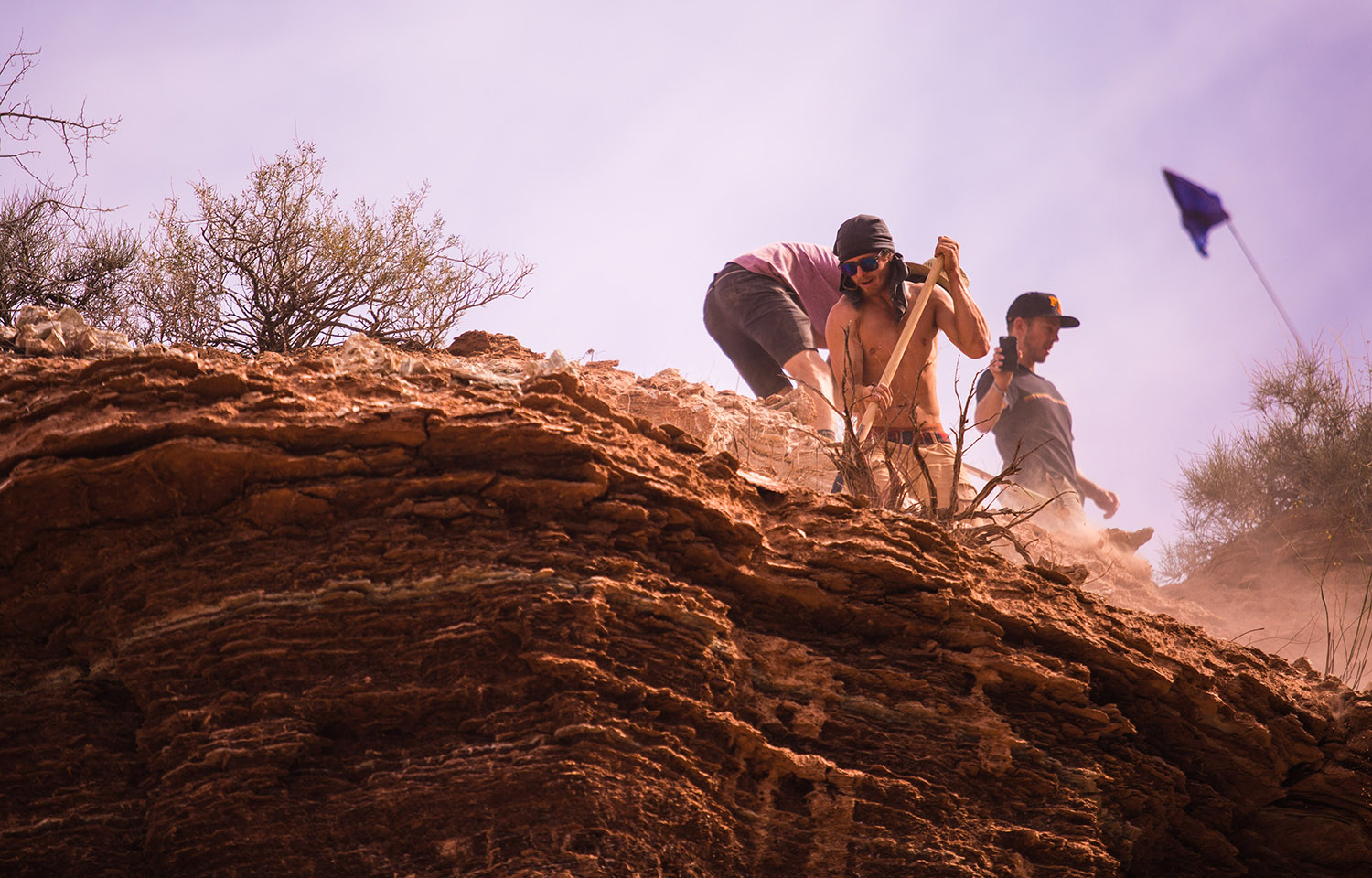 The sweltering heat of the Utah desert makes both digging and riding hard work.