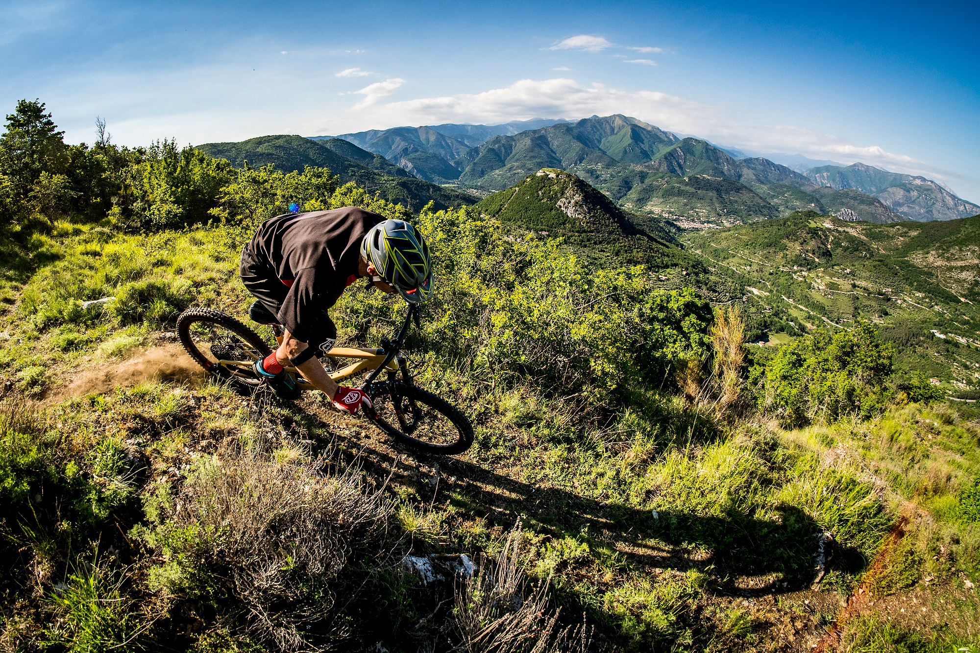 Occasionally I had to stand up and pedal during the hour long descents into the valley floors.              photo: Sven Martin