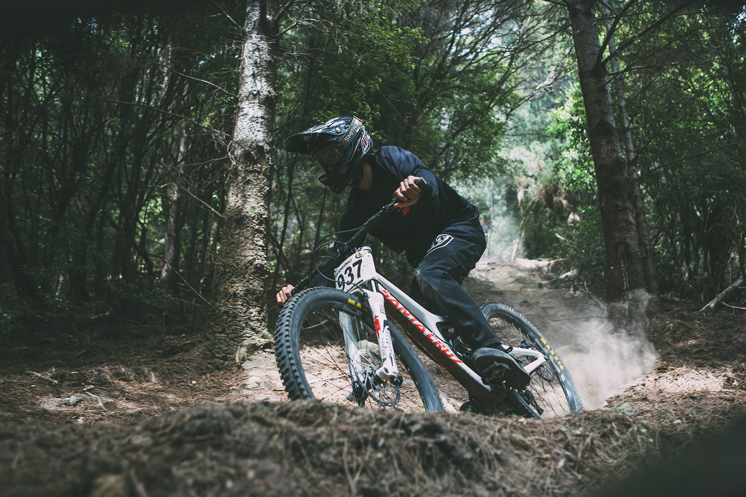 Jacob O'Donoghue-Price buries his Santa Cruz into one of the final berms, lower 'Tim's Track'.