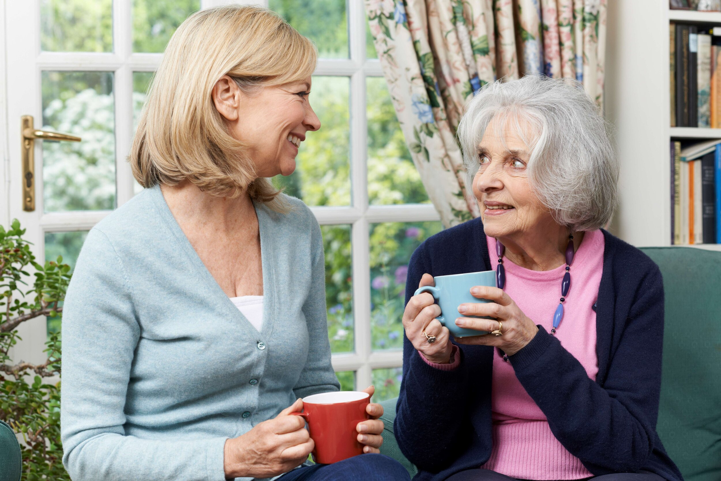 Canva - Woman Taking Time To Visit Senior Female Neighbor And Talk SMALLER.jpg