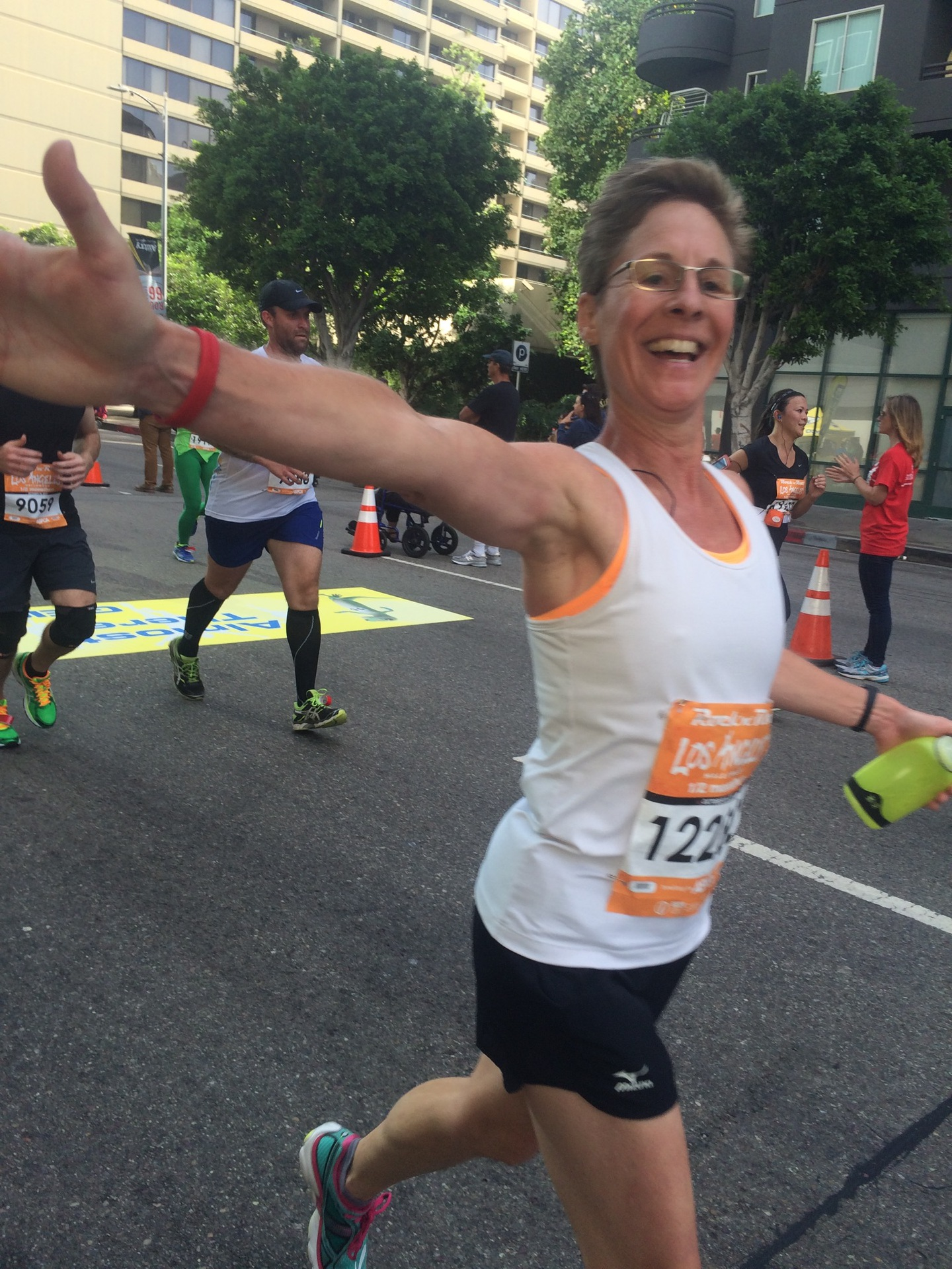 High five at the finish line of my second half-marathon! For my health--and out of curiosity--I took up running when I turned 50.  Together and individually, we can do hard things!