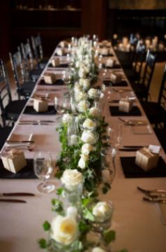 Amangani floral centerpiece: White roses, ivy, salal