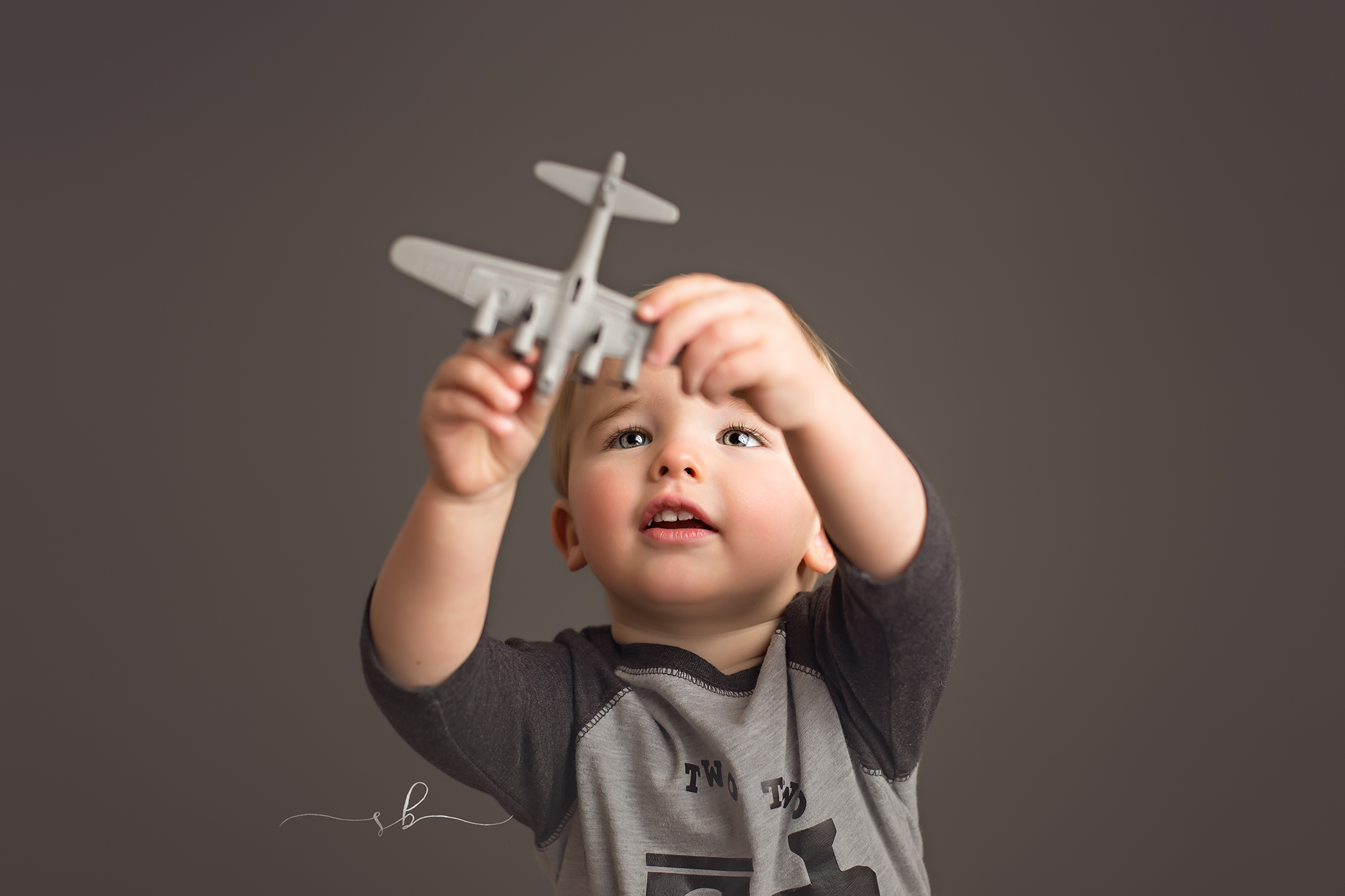 2 year old and toy airplane