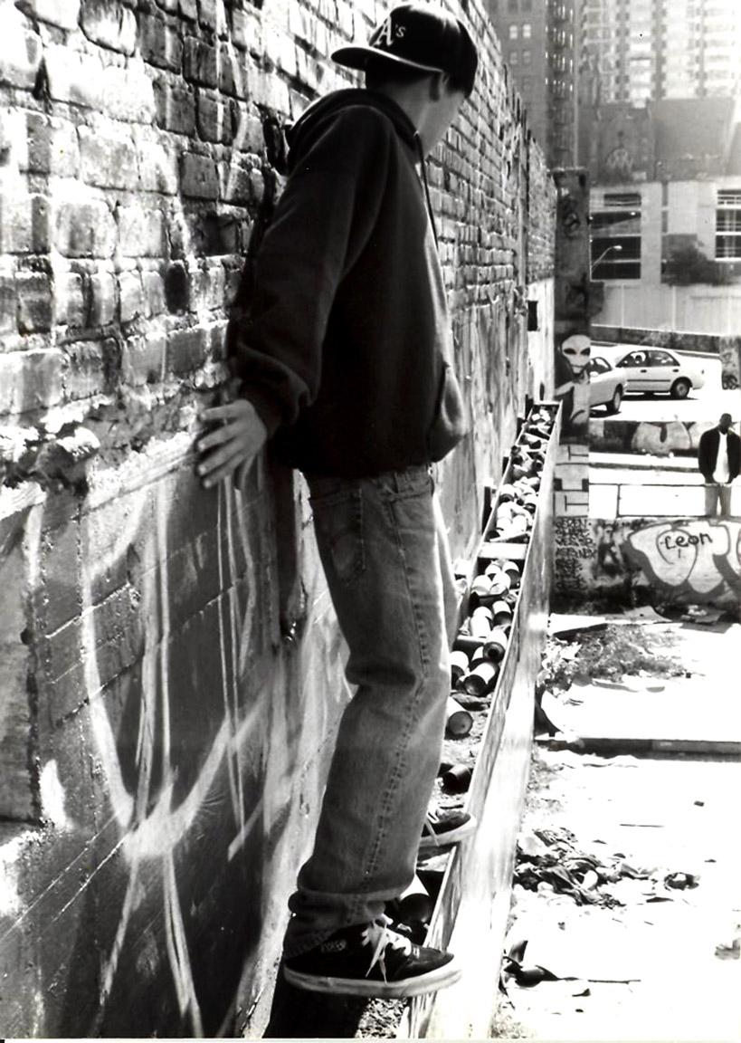 YELAWOLF SCALING GRAFFITI WALL
