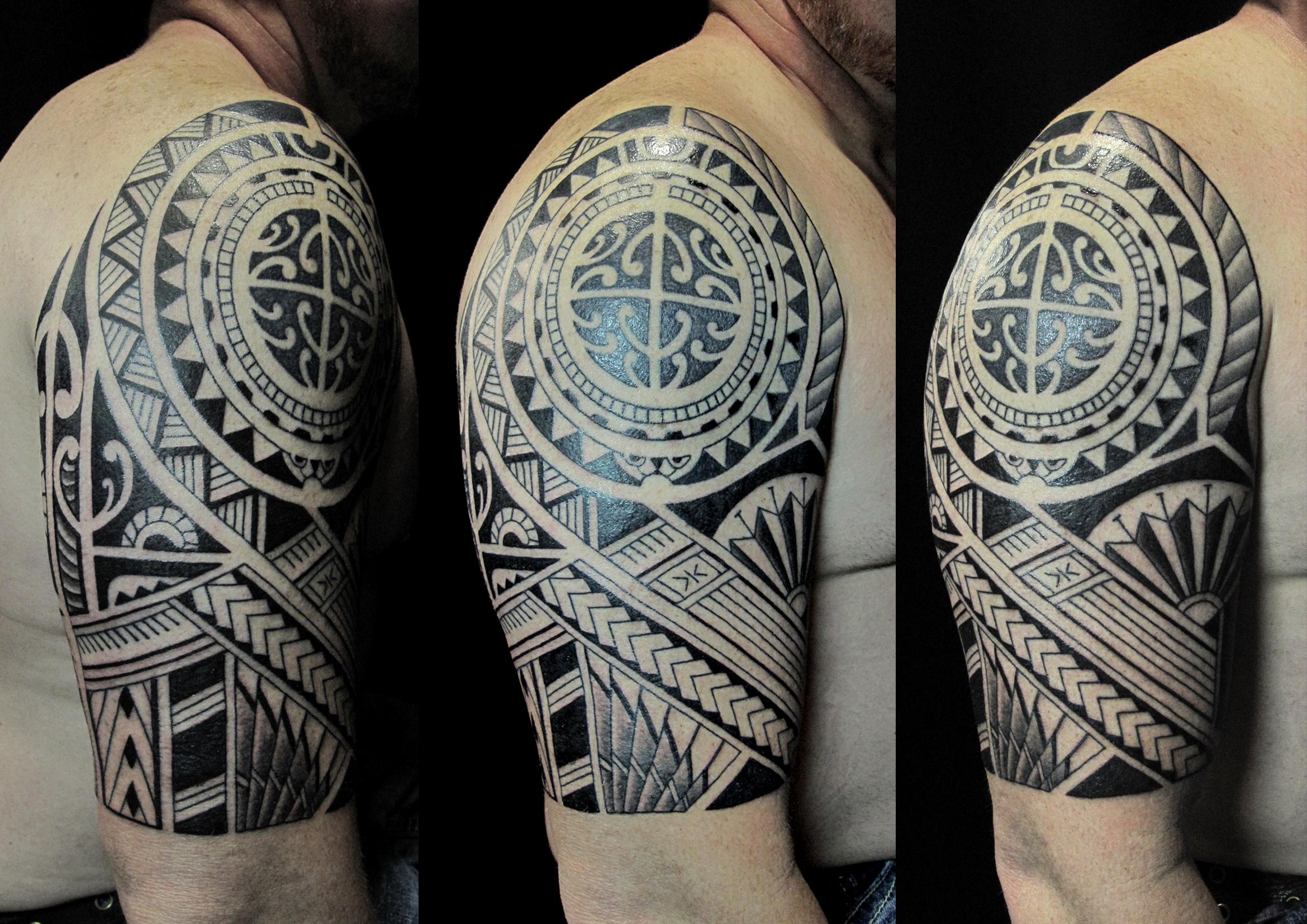 tribal on arm 1.jpg