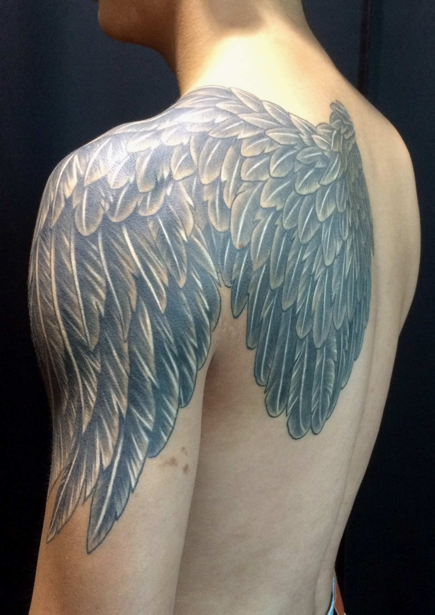 wing tattoo back to arm.jpg