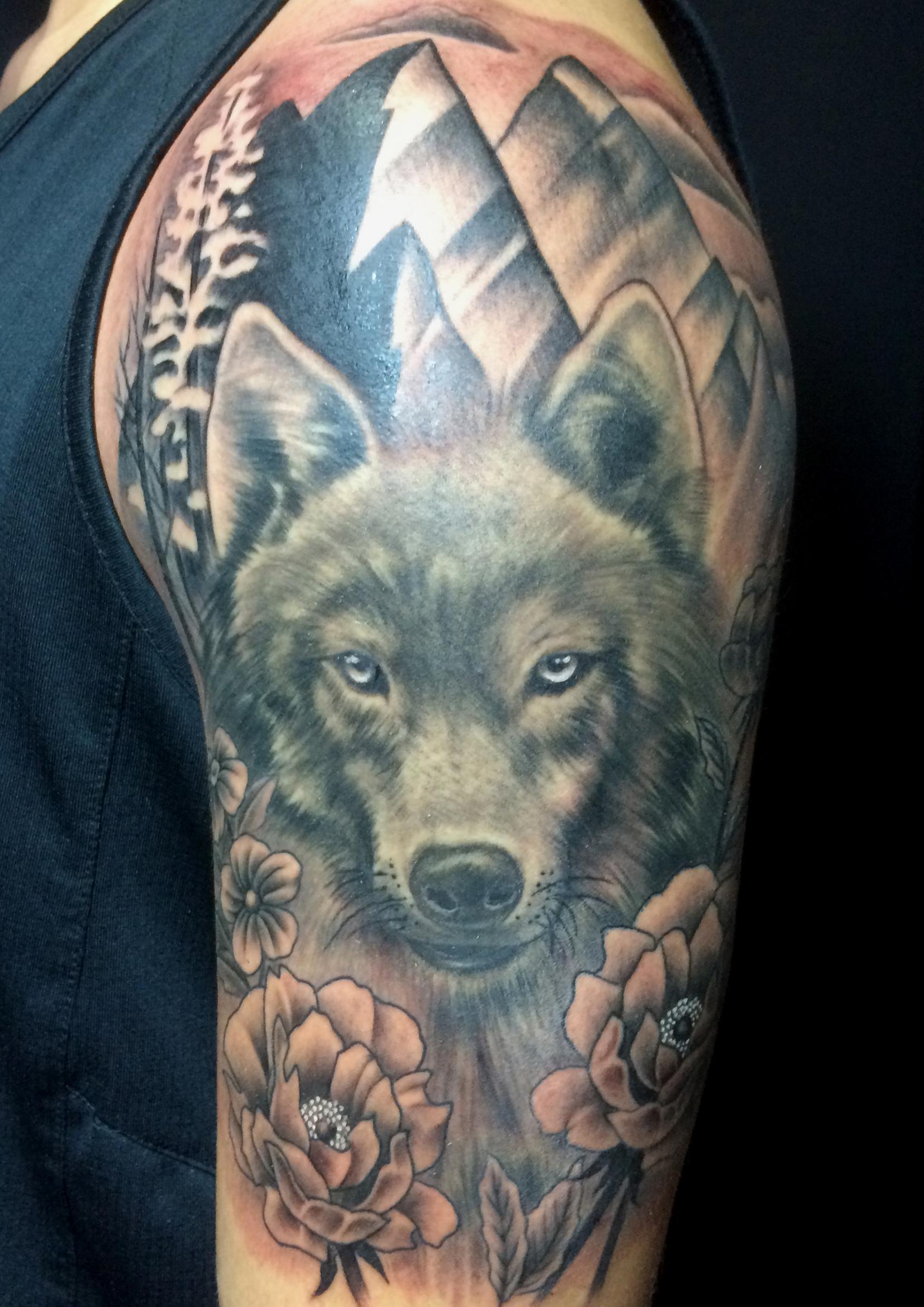 wolf on arm.jpg