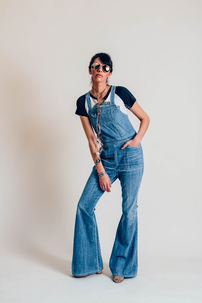 Van Halen Raglan Tee  by Free People.  Citizens of Humanity Kate Denim Overalls  from Nasty Gal.  Aviator sunglasses  by Express. The bolo feather necklace belongs to me. Shoes, model's own.