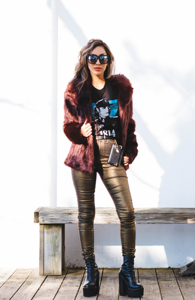 Oxblood faux fur jacket: Oasis for ASOS. Metallic gold high-waist jeans: ASOS. Belted charms purse: ASOS. Janet Jackson tee: Urban Outfitters. Platform boots: Jeffrey Campbell for Nasty Gal. Sunnies: On the Prowl by Quay Australia.