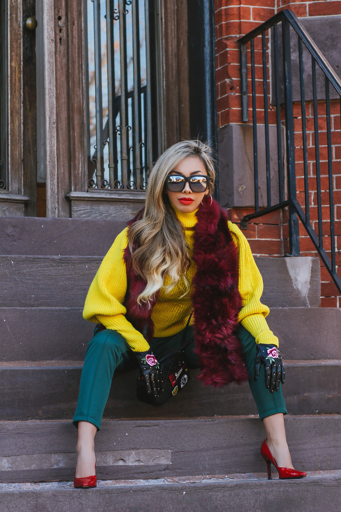 Stitch and Pieces faux fur scarf in Berry. Red stiletto heels by Stuart Weitzman. Forest green skinny track pants by Asos. Yellow balloon sleeve sweater by Warehouse. Leather embroidered gloves by Aldo. Black leather patchwork crossbody bag by Superdry. On The Prowl sunnies by Quay Australia. All items are available in  Shop My Closet .