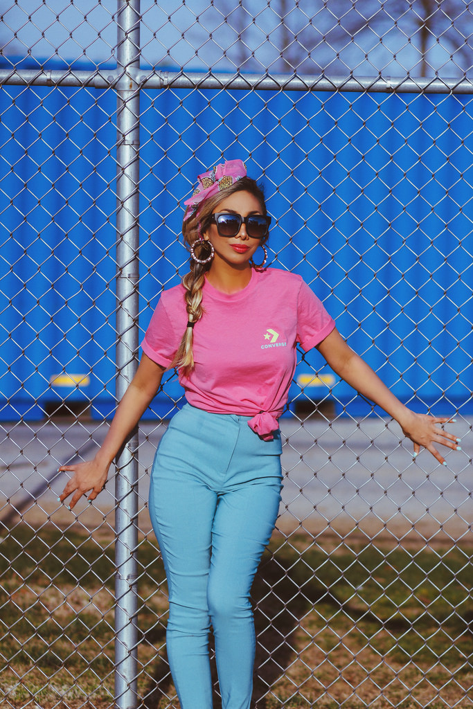 Converse For ASOS t-shirt in pink. Skinny High Waist Pants in blue. ASOS Pineapple Hair Scarf. On The Prowl Sunnies by Quay Australia. Lipstick is  Soap & Glory Sexy Mother Pucker Lip Shine Lacquer  in Riot. All outfit details available in  Shop My Closet .