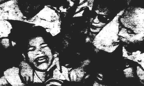 "Original caption: Writhing under a ""vampire"" attack. Clarita Villanueva, 18, of Manila, Philippines, is watched anxiously by the city's mayor (with glasses) as she is held by a police officer, doctor and a nurse. Source: The Barrier Miner, May 28, 1953."