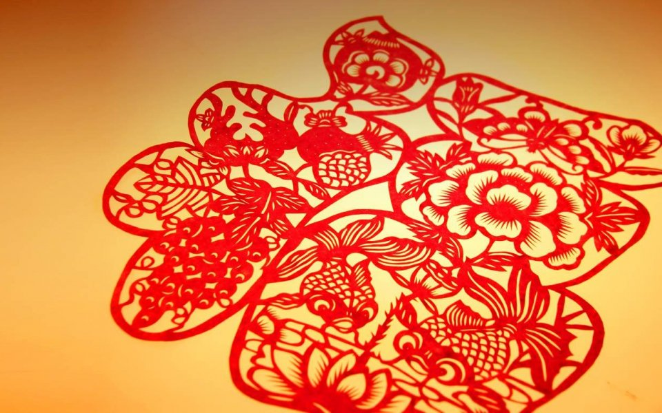 Featuring traditional Chinese papercut and the nation's colors of red and yelllow