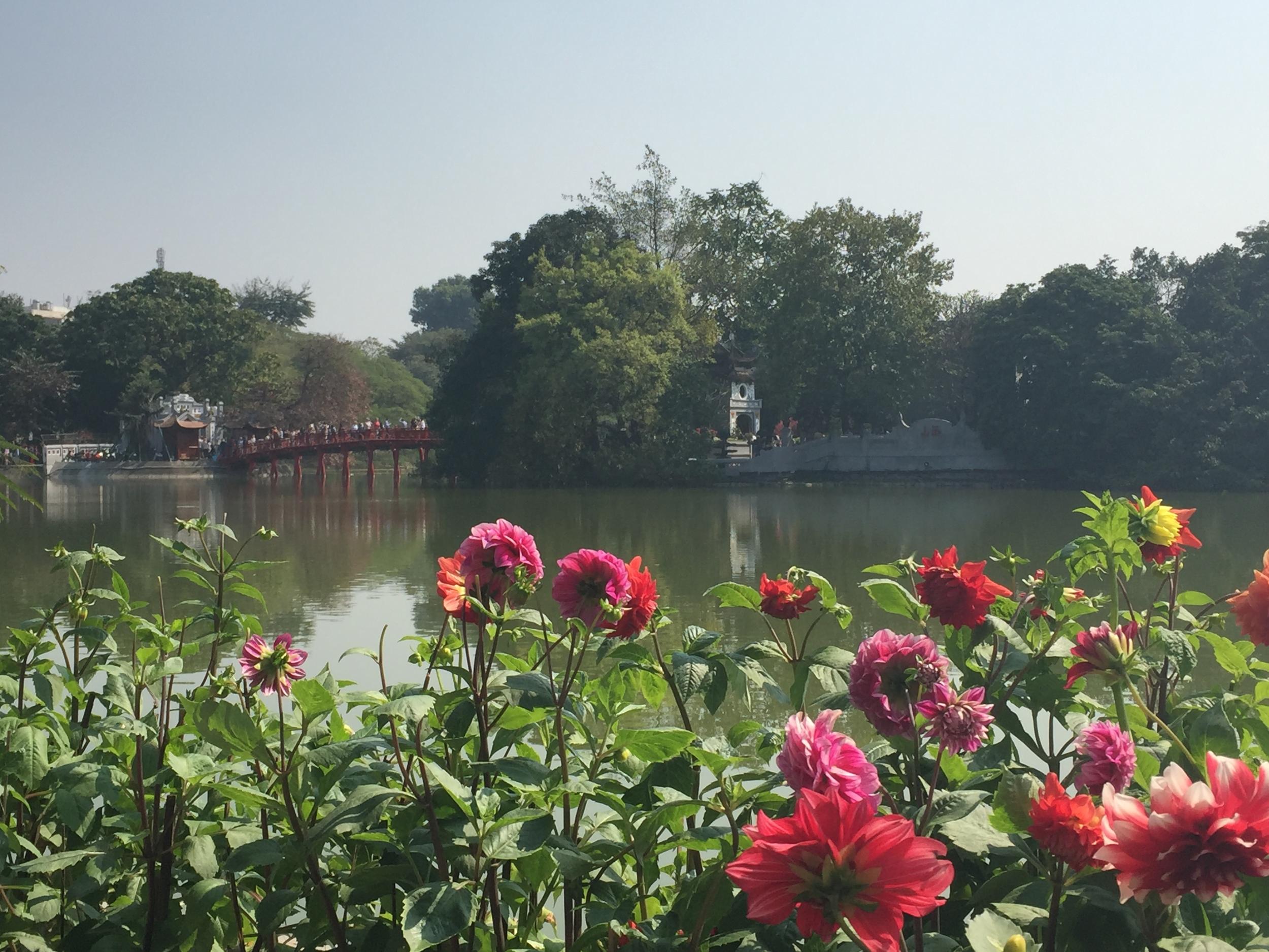 Pretty lake in the historic center of Hanoi. Pretty flowers.