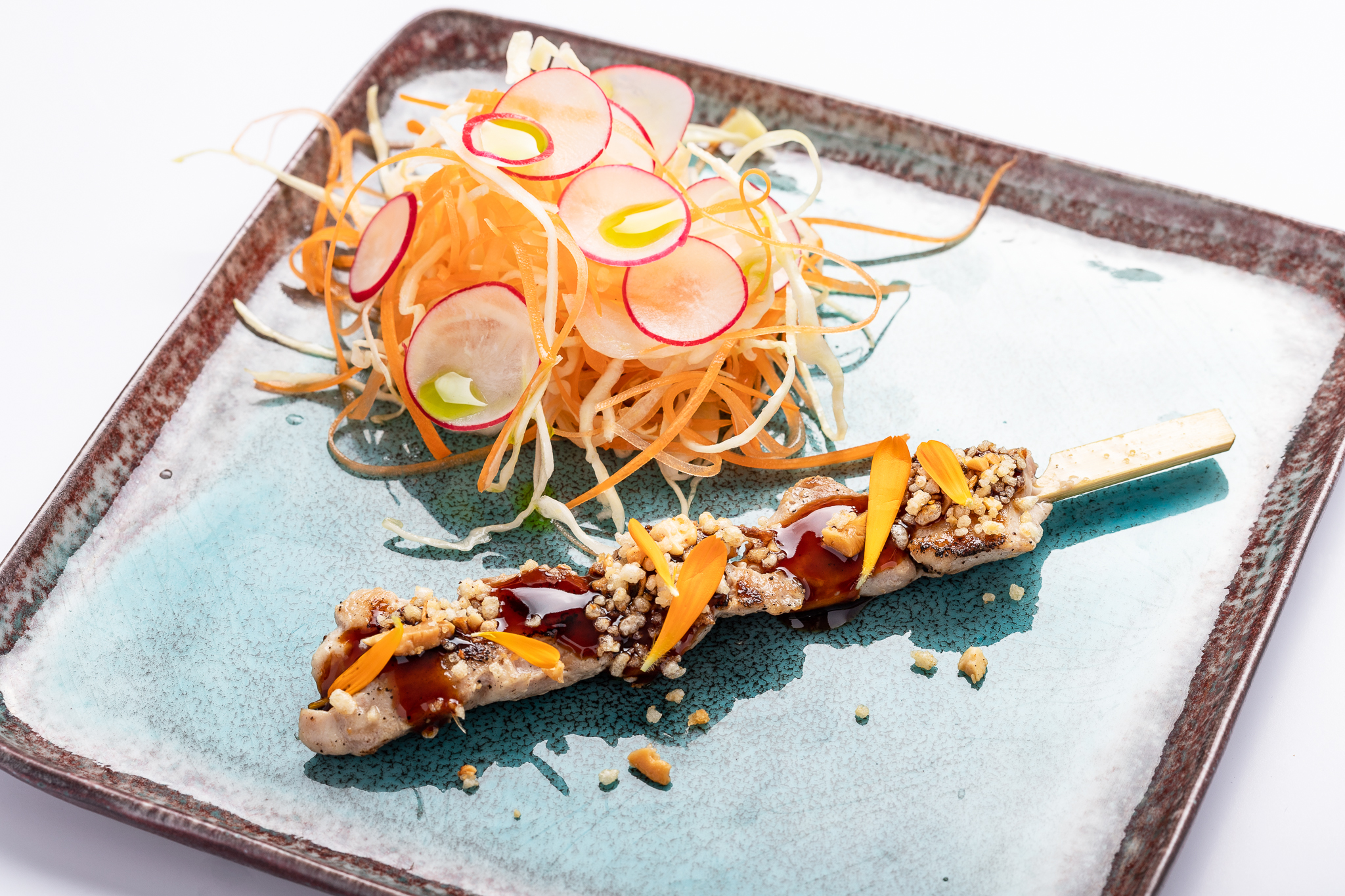 Sticky-chicken-on-a-stick: chicken skewer, crispy oriental salad - ROCK-FORT